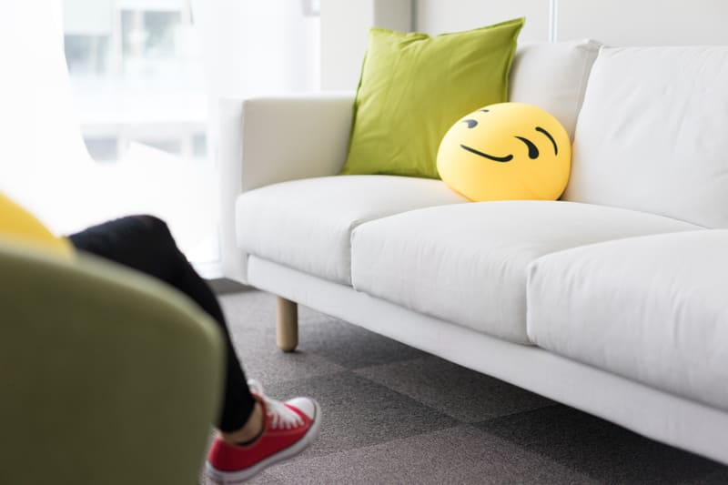 colorful-and-funny-pillows-on-sofa-in-modern-startup-office-picjumbo-com